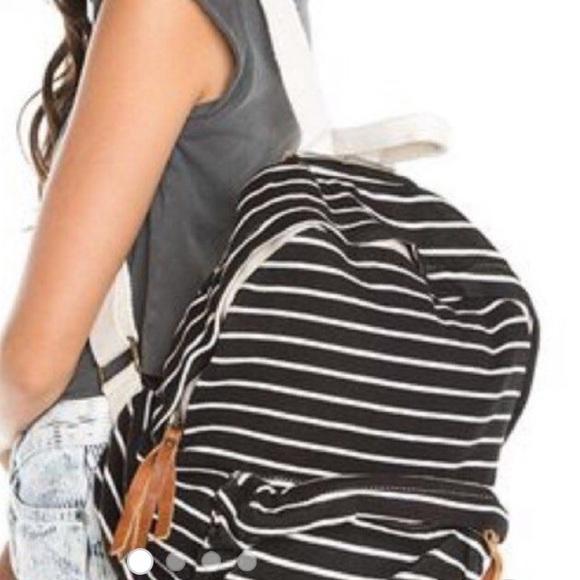 39acb44c4c Brandy Melville Handbags - brandy melville john galt striped backpack